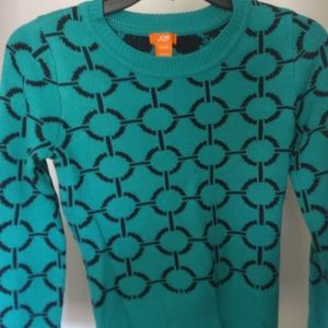 Turquoise sweater with dark blue pattern